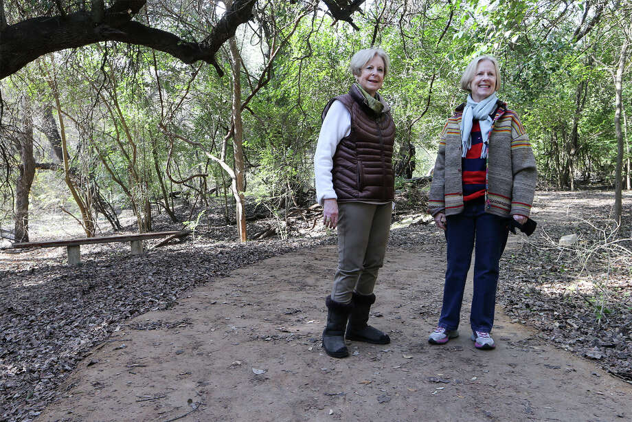 Susan Farrimond (left) and Sally Ann Smith with the Friends of Hondondo Creek Trail stand on a  trail made of StaLok along the creek.   The group has installed 230 feet of the stabilized natural aggregate on the trail   and hopes to  install 4,800 feet more. Photo: Marvin Pfeiffer / San Antonio Express-News / Express-News 2015