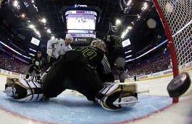 A second-period shot by Team Toews gets past goalie Marc Andre-Fleury of Team Foligno.