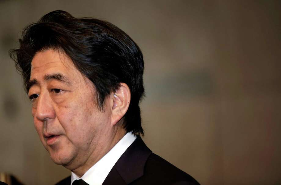 """Japanese Prime Minister Shinzo Abe speaks to the media after he signed a book of condolence for the late King Abdullah of Saudi Arabia at Saudi Arabian Embassy in Tokyo Sunday, Jan. 25, 2015. Abe said earlier in the day he was """"speechless"""" after an online video purportedly showed that one of two Japanese hostages of the extremist Islamic State group had been killed, and he demanded the release of the other. The Associated Press has not verified the contents of the video, which varied greatly from previous videos released by the Islamic State group. It holds a third of both Syria and Iraq. (AP Photo/Eugene Hoshiko) Photo: Eugene Hoshiko, STF / AP"""