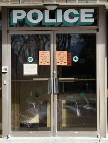 Signs on the front door of the Guilderland Police station give direction to the front door of the Guilderland Town Hall Tuesday afternoon Jan. 20, 2015 in Guilderland, N.Y.    (Skip Dickstein/Times Union) Photo: SKIP DICKSTEIN / 00030280A