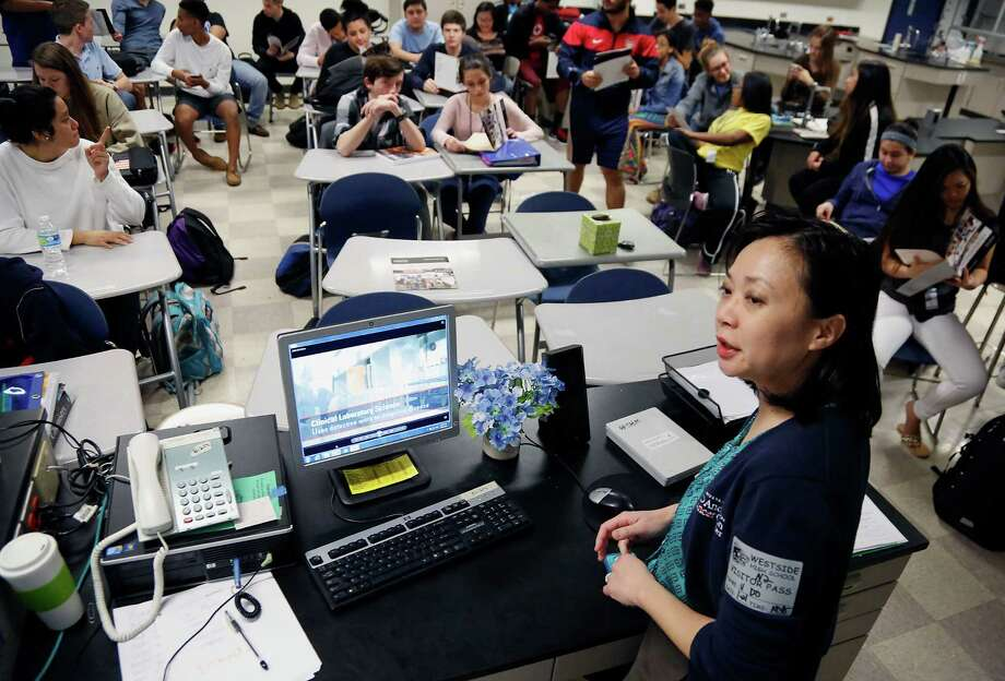 University of Texas M.D. Anderson Cancer Center's Nghi Do speaks to Westside High School students who are participating in a program that trains them for medical careers and allows them to earn college credit. Photo: James Nielsen, Staff / © 2015  Houston Chronicle