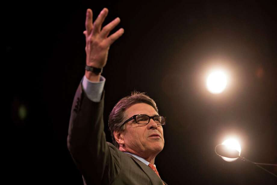 Rick Perry, former governor of Texas, speaks during the Iowa Freedom Summit in Des Moines, Iowa, U.S., on Saturday, Jan. 24, 2015. The talent show that is a presidential campaign began in earnest Saturday as more than 1,200 Republican activists, who probably will vote in Iowa's caucuses, packed into a historic Des Moines theater to see and hear from a parade of their party's prospective entries. Photographer: Daniel Acker/Bloomberg *** Local Caption *** Rick Perry Photo: Daniel Acker, Bloomberg / © 2015 Bloomberg Finance LP