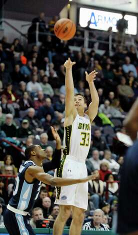 Rob Poole of Siena puts up a shot during their game against Saint Peter's at the Times Union Center on Sunday, Jan. 25, 2014, in Albany, N.Y.    (Paul Buckowski / Times Union) Photo: Paul Buckowski / 00030241B