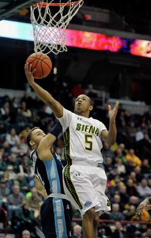 Evan Hymes of Siena drives to the basket for two points  during their game against Saint Peter's at the Times Union Center on Sunday, Jan. 25, 2014, in Albany, N.Y.    (Paul Buckowski / Times Union) Photo: Paul Buckowski / 00030241B