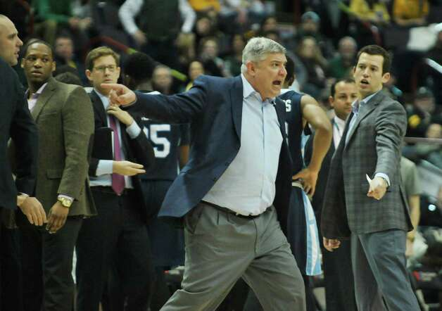 Jimmy Patsos , Siena head coach, yells at a referee at the end of the first half during their game against Saint Peter's at the Times Union Center on Sunday, Jan. 25, 2014, in Albany, N.Y.    (Paul Buckowski / Times Union) Photo: Paul Buckowski / 00030241B
