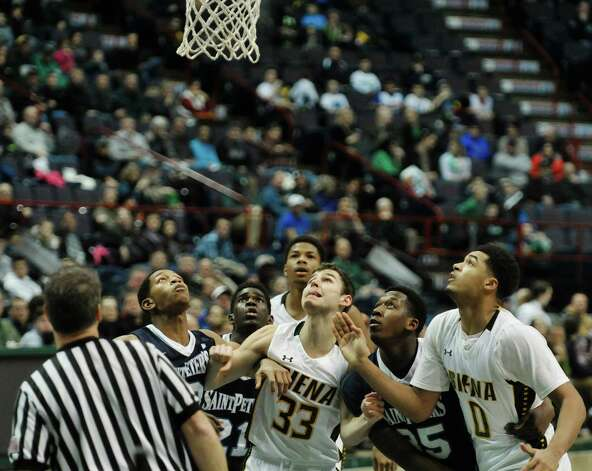 Siena and Saint Peter's players wait to jump for a rebound during their game at the Times Union Center on Sunday, Jan. 25, 2014, in Albany, N.Y.    (Paul Buckowski / Times Union) Photo: Paul Buckowski / 00030241B
