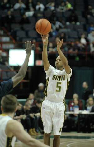 Evan Hymes of Siena puts up a shot during their game against Saint Peter's at the Times Union Center on Sunday, Jan. 25, 2014, in Albany, N.Y.    (Paul Buckowski / Times Union) Photo: Paul Buckowski / 00030241B