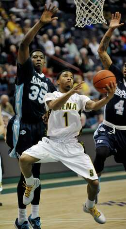 Marquis Wright of Siena lays up a shot during their game against Saint Peter's at the Times Union Center on Sunday, Jan. 25, 2014, in Albany, N.Y.    (Paul Buckowski / Times Union) Photo: Paul Buckowski / 00030241B