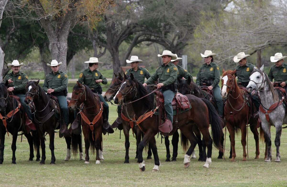 The U.S. Border Patrol mounted horse patrol unit stands by in Mission,during a congressional delegation's visit last week.