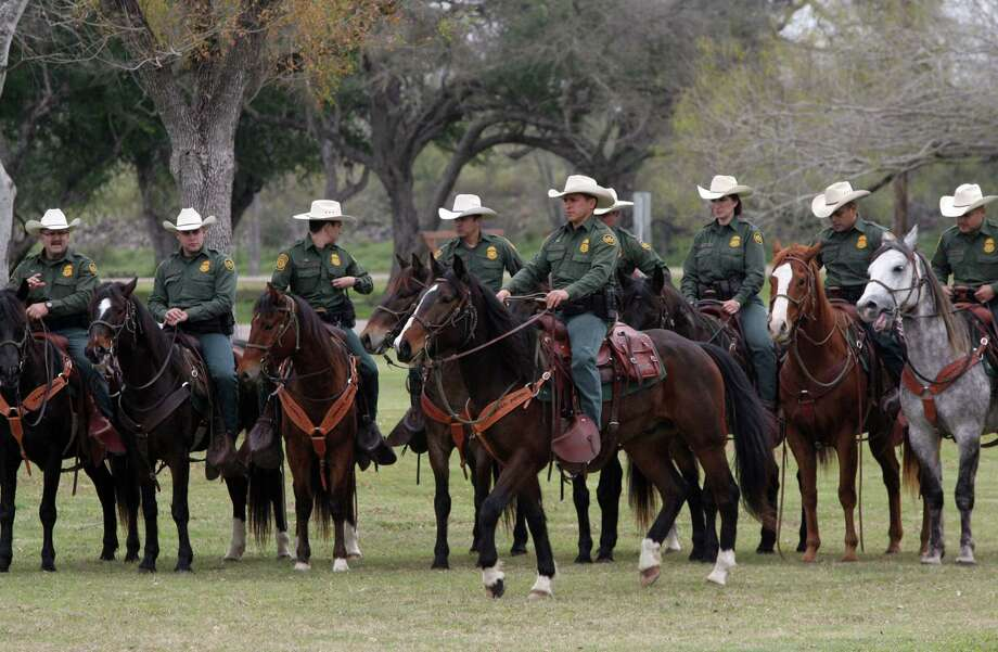 The U.S. Border Patrol mounted horse patrol unit stands by in Mission,during a congressional delegation's visit last week. Photo: Delcia Lopez /Associated Press / The Monitor