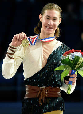 Jason Brown, 20, won the U.S. figure-skating championship with a record point total.