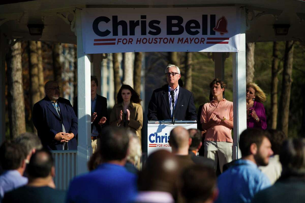 Surrounded by his family, former city councilman and ex-congressman Chris Bell announces his candidacy for mayor of Houston at the Sam Houston Park on Sunday. He acknow-ledged the race could get ugly.