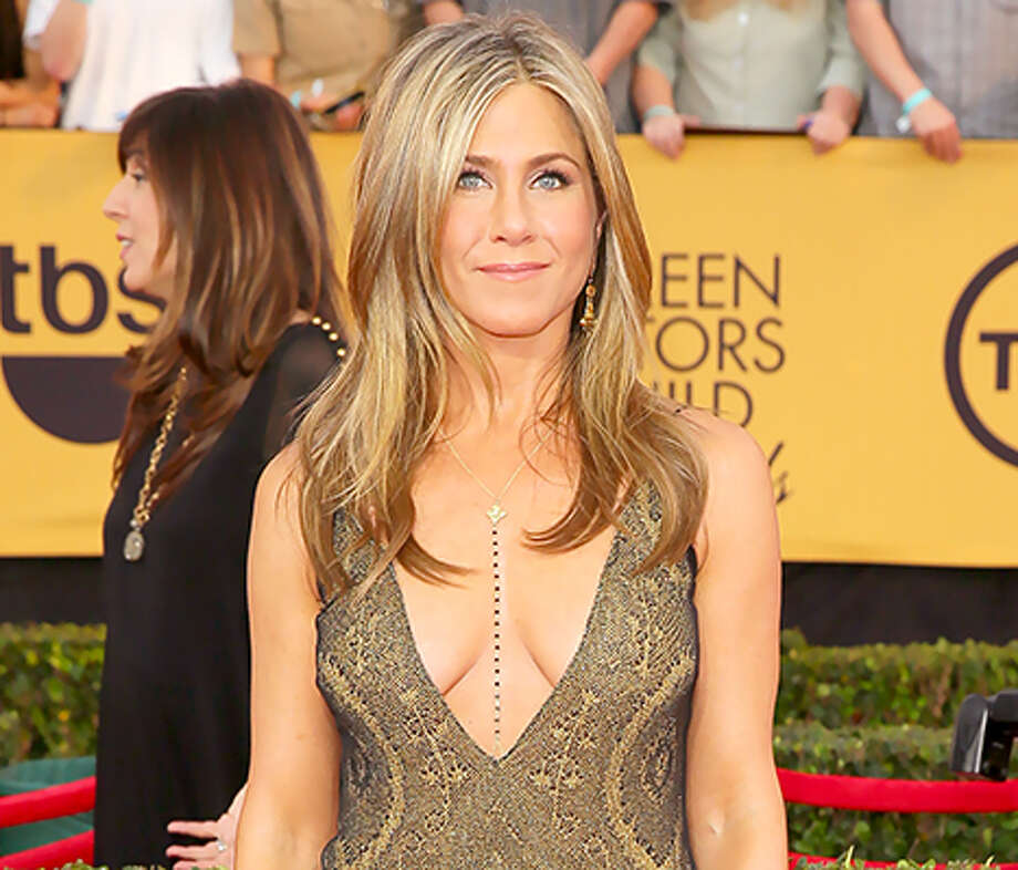 The plunging neckline dress has been around for ages, but Jennifer Aniston took it to a whole new level at the SAG Awards when she paired it with a necklace that directs the eye toward her belly button. Keep clicking to see how other actresses have attempted the daring neckline.  / 2015 WireImage