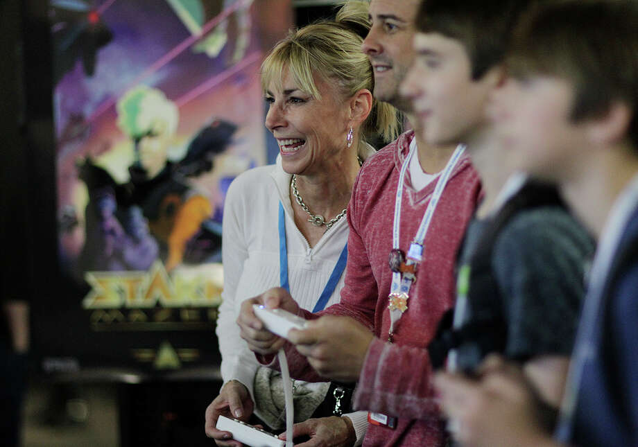 "Joni Baker, of Houston, plays ""Sportsball,"" during Pax South 2015 gaming convention at the Henry B. Gonzalez Convention Center, Sunday, Jan. 25, 2015. The event started on Friday and ended Sunday. Photo: JERRY LARA, San Antonio Express-News / © 2015 San Antonio Express-News"