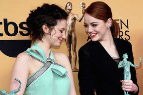 (L-R) Actresses Andrea Riseborough, Emma Stone and Amy Ryan, winners of Outstanding Performance by a Cast in a Motion Picture for 'Birdman,' pose in the press room at the 21st Annual Screen Actors Guild Awards at The Shrine Auditorium on January 25, 2015 in Los Angeles.