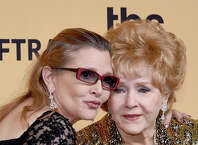 Actresses Debbie Reynolds (R), recipient of the Screen Actors Guild Life Achievement Award, and Carrie Fisher pose in the press room at the 21st Annual Screen Actors Guild Awards at The Shrine Auditorium on January 25, 2015 in Los Angeles.