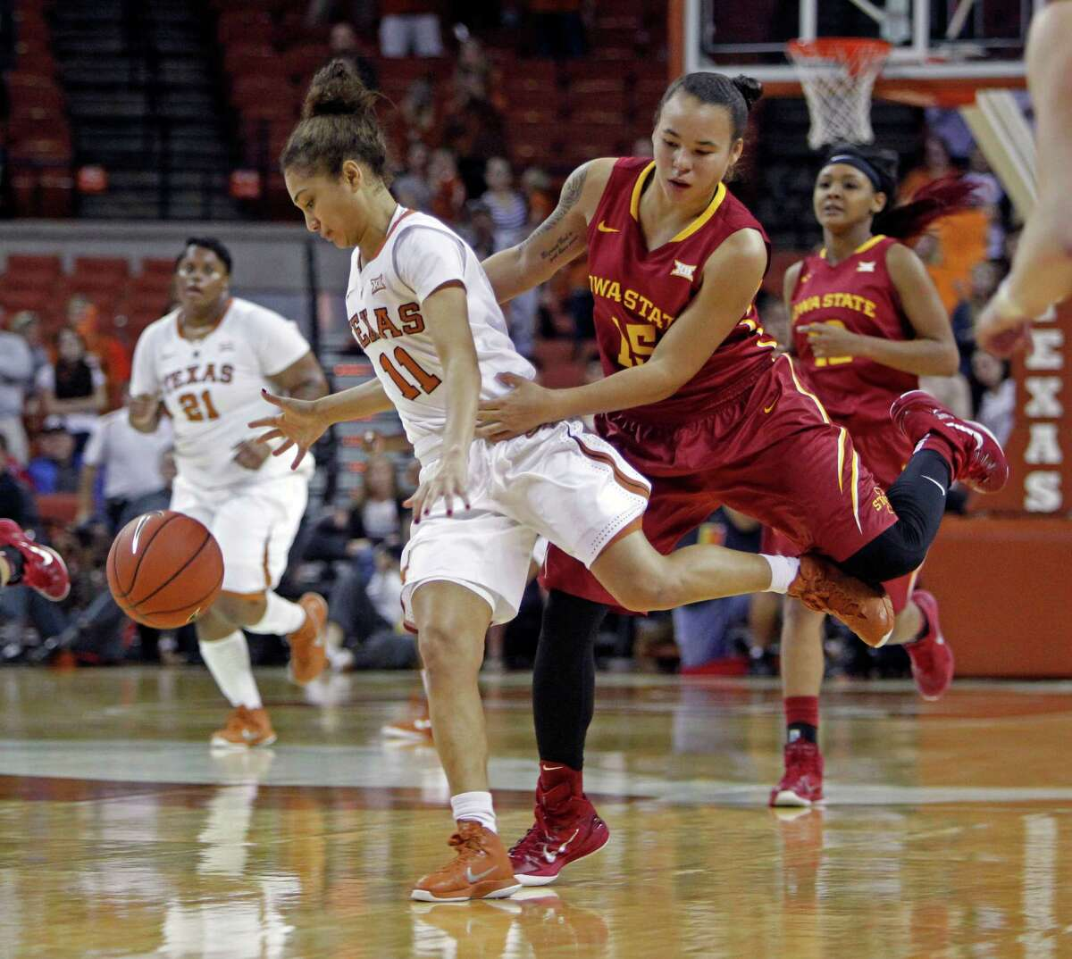 Iowa State's Nicole Blaskowsky, right, commits a foul by grabbing Texas' Brooke McCarty.