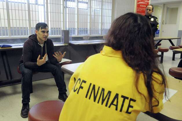 Joseph Filippone, left, director of prevention services with Project Safe Point, talks with inmates at the Albany County Jail on Friday Jan. 23, 2015, in Colonie, N.Y., about the use of Narcan to help save lives of those who overdose on heroin. (Michael P. Farrell/Times Union) Photo: Michael P. Farrell / 00030292A