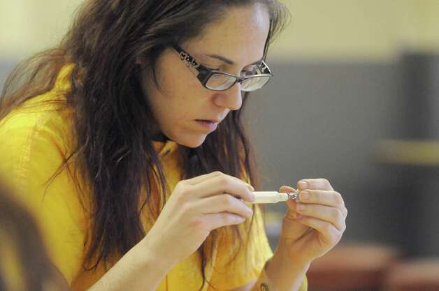 Inmate Stephanie Hope from Cohoes learns about the use of Narcan to help save lives of those who overdose on heroin at the Albany County Jail on Friday Jan. 23, 2015 in Colonie, N.Y. (Michael P. Farrell/Times Union) Photo: Michael P. Farrell / 00030292A
