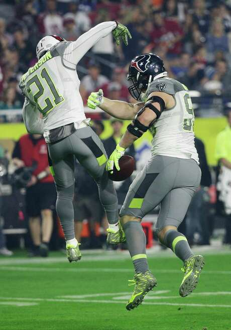 Patrick Peterson (21) of Team Carter congratulates J.J. Watt on his fumble recovery during the third quarter of Sunday night's Pro Bowl. Photo: David J. Phillip, STF / AP