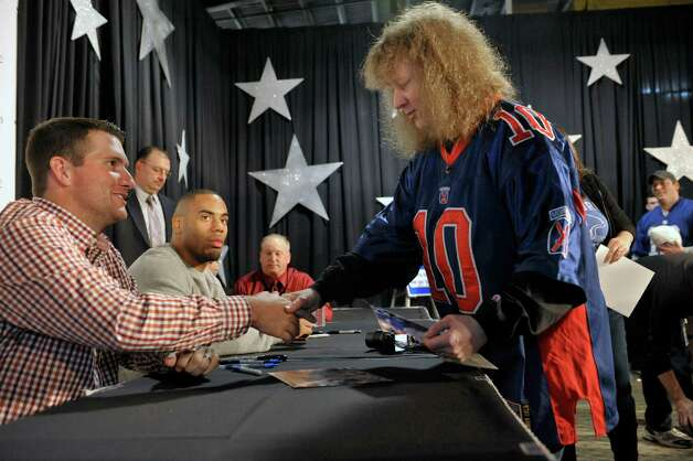 New York YankeesO pitcher Adam Warren, left, meets Simone Zalewski of Rotterdam, as New York GiantsO running back Rashad Jennings looks on at the 55th Annual Center for Disability Services Telethon on Sunday, Jan. 25, 2015, in Albany, N.Y.  The two sports stars met with people and signed autographs.  The athletes were brought in courtesy of UHY LLP Certified Public Accountants.    (Paul Buckowski / Times Union) Photo: Paul Buckowski / 00030301A