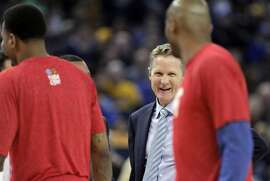 Warriors head coach Steve Kerr smiles at Leandro Barbosa in the second half as the Golden State Warriors played the Boston Celtics at Oracle Arena in Oakland, Calif., on Sunday, January 25, 2015. The Warriors won 114-111.