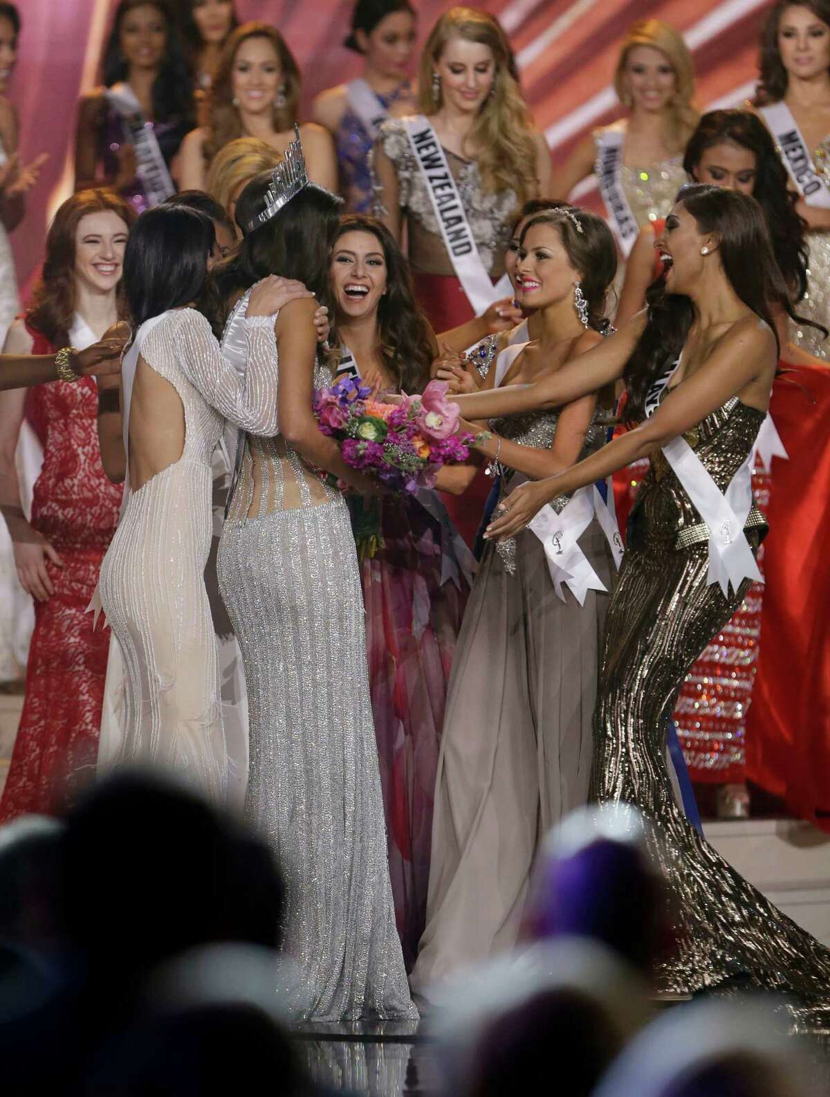 Miss Colombia Paulina Vega is congratulated by contestants after becoming Miss Universe at the Miss Universe pageant in Miami, Sunday, Jan. 25, 2015.