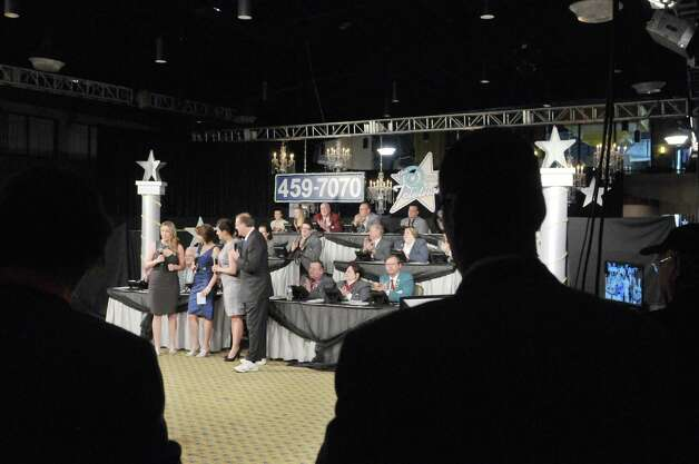 People gather around to watch the opening moments of the 55th Annual Center for Disability Services Telethon on Sunday, Jan. 25, 2015, in Albany, N.Y.     (Paul Buckowski / Times Union) Photo: Paul Buckowski / 00030341A