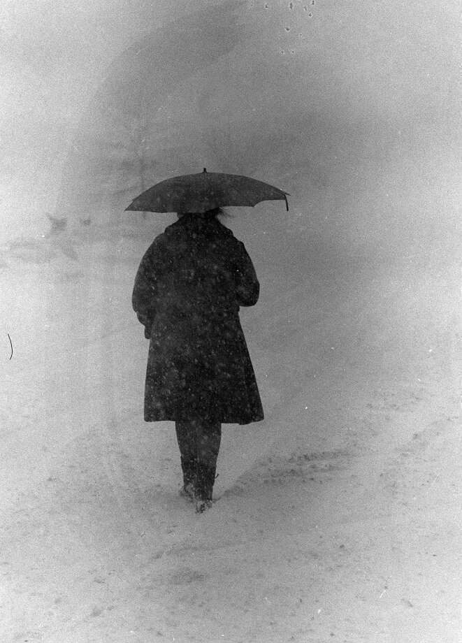 A woman walking in the blinding snow on Main St in Danbury during the Blizzard of