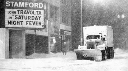 A plow battles blowing snow in downtown Stamford during the height of the Blizzard of '78. By the time the three-day storm stopped, more than 15 inches of snow fell with strong winds that blew drifts more than 30 inches.