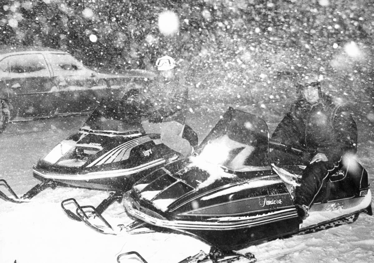 Men on snowmobiles make their way through Greenwich, Conn. during the Blizzard of 1978. By the time the three-day storm stopped, more than 15 inches of snow fell with strong winds that blew drifts more than 30 inches.