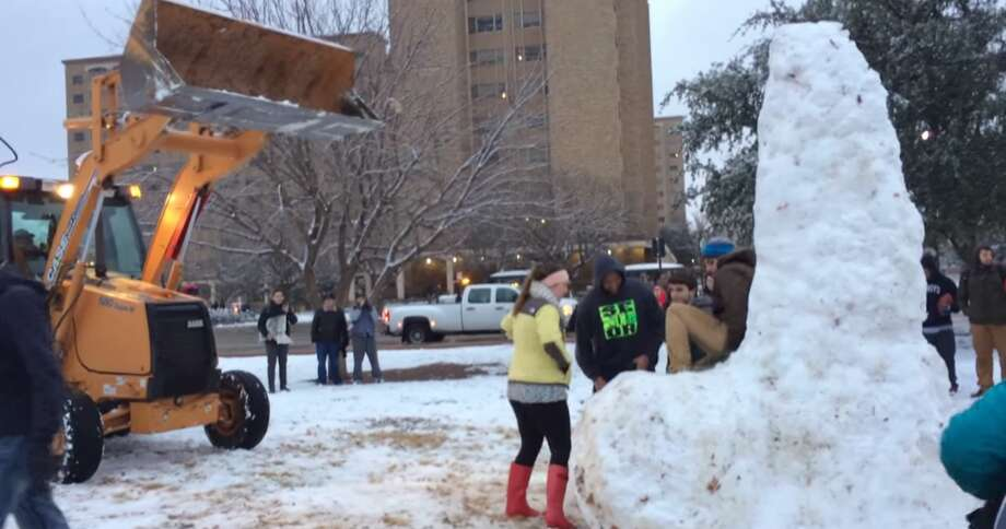 """A group of mostly male students at Texas Tech University staged a heroic last stand before a bulldozer demolished their beloved snow sculpture of a giant penis.  The 11-foot-tall sculpture, built in """"one of the most popular places on campus,"""" took about four hours and up to ten students to complete, according to a video description on Newsflare. Photo: Screenshot Via YouTube"""