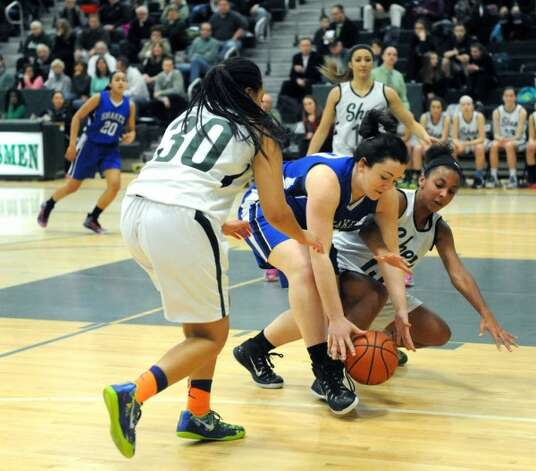 Shaker's Becky Rossieer, center, Shen's Samira Sangare, left, and Sydney Brown battle for a loose ball during their girl's high school basketball game on Tuesday Jan. 13, 2015 in Clifton Park, N.Y. (Michael P. Farrell/Times Union)