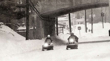 Three men ride snowmobiles on Long Ridge Road in Stamford, Conn. during the blizzard of 1978.