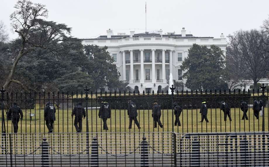 Secret Service officers search the south grounds of the White House in Washington, Monday, Jan. 26, 2015. A device, possibly an unmanned aerial drone, was found on the White House grounds during the middle of the night while President Barack Obama and the first lady were in India, but his spokesman said Monday that it posed no threat. (AP Photo/Susan Walsh) Photo: Susan Walsh, Associated Press