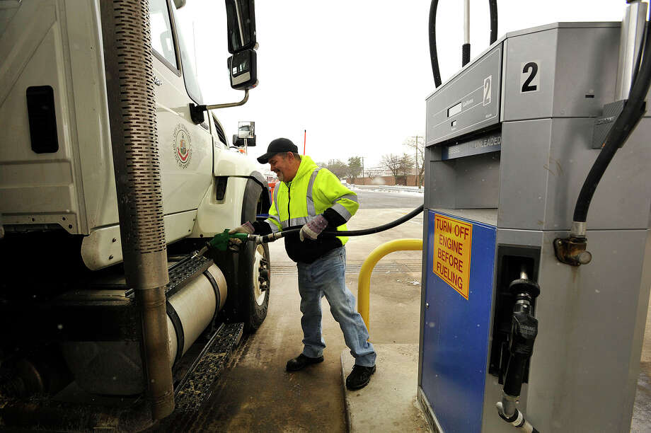 City equipment operator John Pandone attempts to fill up his plow truck in preparation for the oncoming snow storm at the city garage on Magee Avenue in Stamford, Conn., on Monday, Jan. 26, 2015. Photo: Jason Rearick / Stamford Advocate