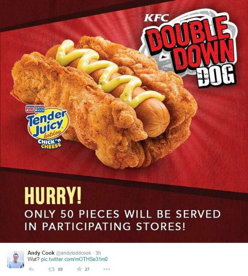 """KFC's new """"Double Down Dog,"""" being tested in 11 stores in the Phillipines, is basically a hot dog slathered in cheese shoved into a piece of fried chicken shaped like a hot dog bun. Photo: Screenshot Via Twitter"""