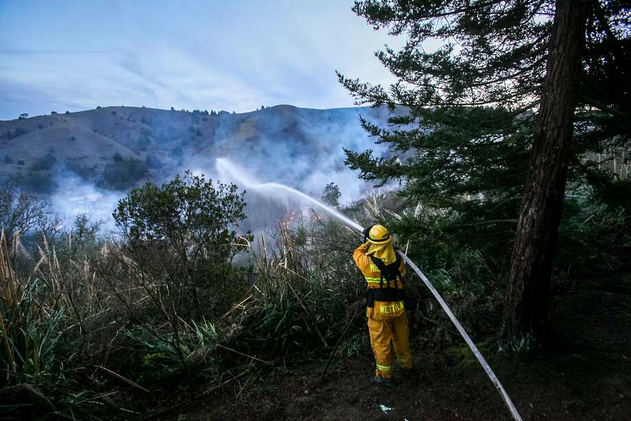 Firefighters battle a 6-alarm brush fire that began on Fassler Avenue and spread to Rockaway Beach Avenue, Monday, Jan. 26, 2015, in Pacifica, Calif. Photo: Santiago Mejia, The Chronicle
