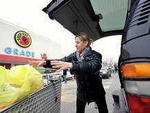 Chris Smith, of Stamford, loads up the back of her vehicle at the Shop Rite on Shippan Avenue in Stamford, Conn., on Monday, Jan. 26, 2015. Chris says that she's not worried about the impending snow storm.