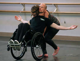 Dwayne Scheuneman and Sophie Stanley dance in a rehearsal attended by Jane Chu, chairwoman of the National Endowment for the Arts, at the AXIS Dance Company studio in Oakland, Calif. on Tuesday, Jan 13, 2015.