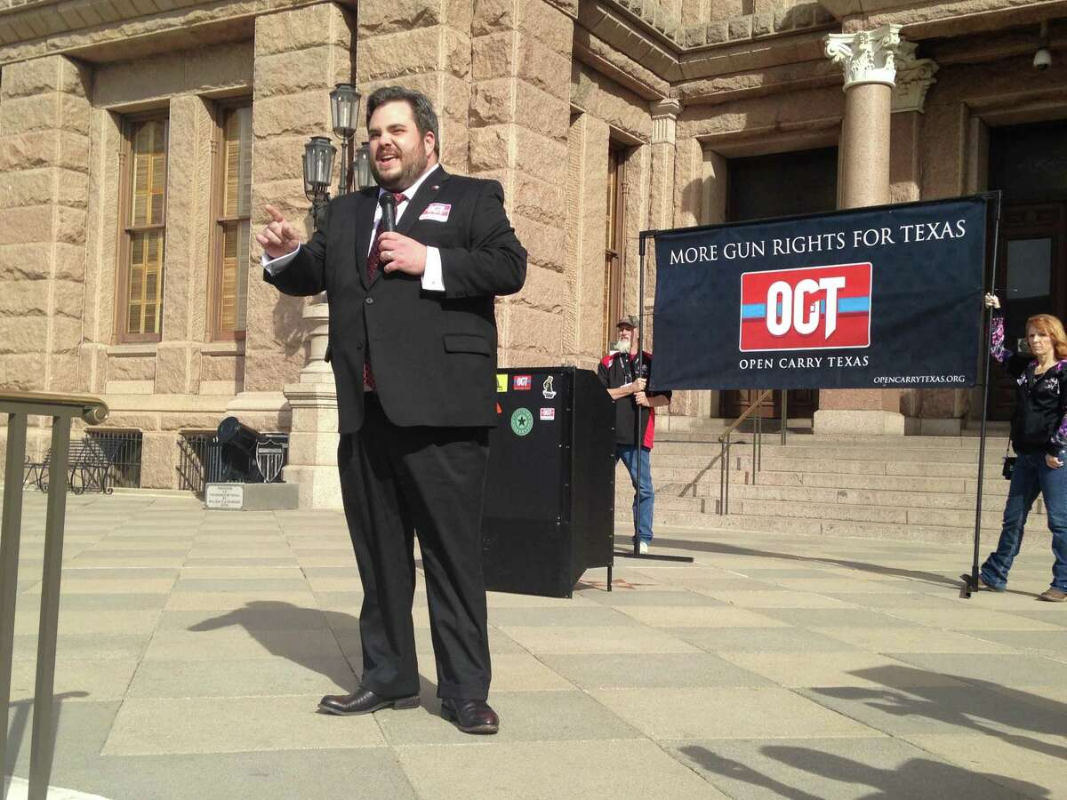 Rep. Jonathan Stickland, R-Bedford, addresses open carry activists gathered on the steps of the state Capitol in Austin on Monday, Jan. 26, 2015. The demonstrators support Rep. Jonathan Stickland's House Bill 195, which would legalize unlicensed open carry of handguns.