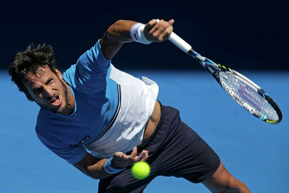 A powerful serve by Feliciano Lopez of Spain hit an  Australian Open ball boy where it hurts. Photo: Bernat Armangue, STF / AP