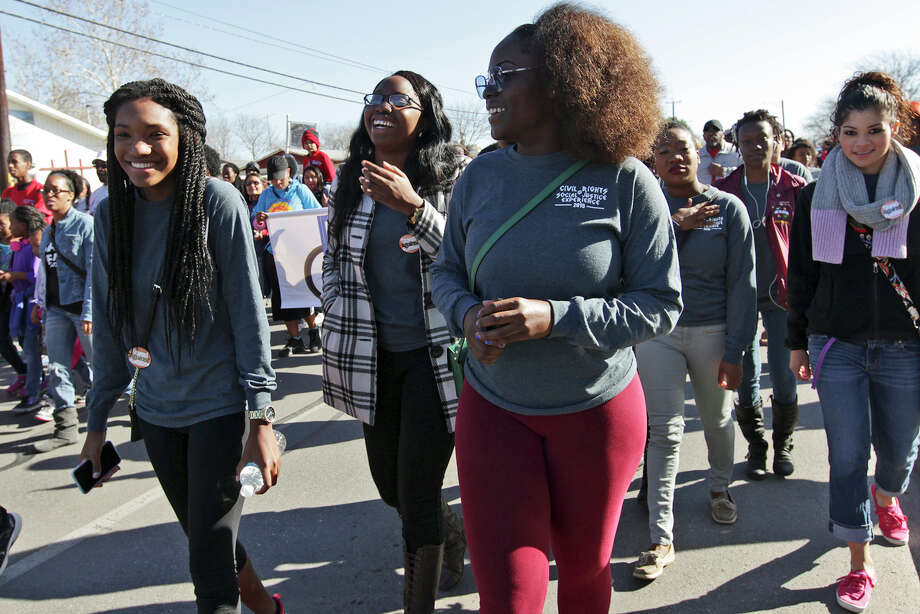 University of Texas at San Antonio Student Leadership Center students, from left, Jannelle Henry, Robin Koko and Kemi Omotola participate in the annual San Antonio Martin Luther King Jr. March in the city's Eastside, Monday, Jan. 19. Photo: Jerry Lara /San Antonio Express-News / © 2015 San Antonio Express-News