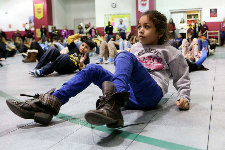Students perform a special fitness dance as San Antonio Sports launches its 2015 University Health System Go!Kids Challenge at Rayburn Elementary on Jan. 22. Photo: Marvin Pfeiffer /Southside Reporter / Express-News 2015