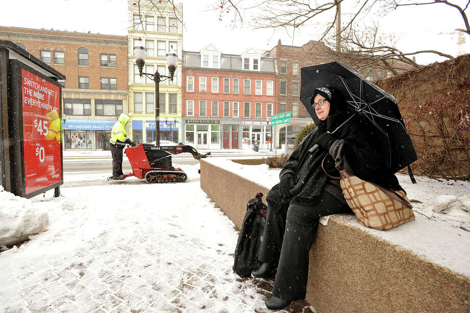 Stamford resident Amina Ali waits for her bus in downtown Stamford, Conn., while on her way home from the hospital on Monday, Jan. 26, 2015. Photo: Jason Rearick / Stamford Advocate