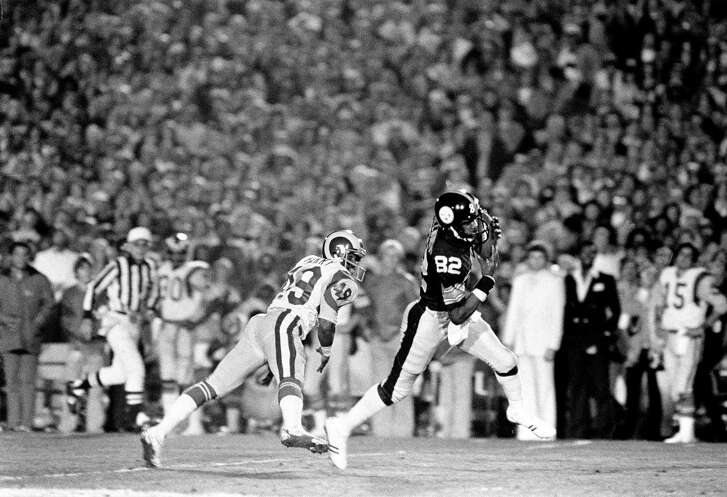 Pittsburgh Steelers receiver John Stallworth (82) makes a touchdown ahead of Los Angeles Rams defender Rod Perry (49) during the fourth quarter of Super Bowl XIV in Pasadena, Calif., Jan. 20, 1980.  (AP Photo)