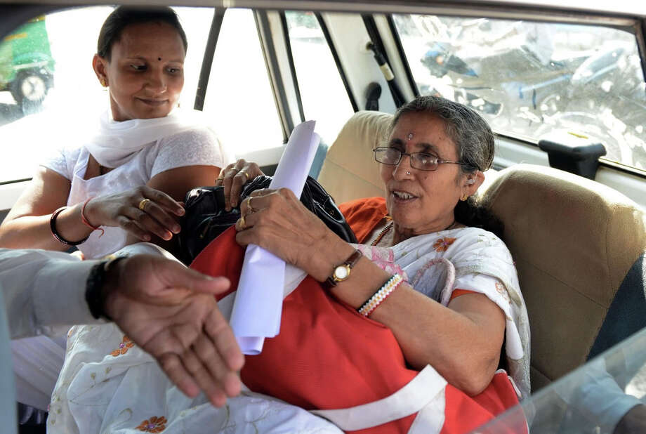 Jashodaben Modi, right, is a retired teacher who has not heard from her husband in years. Photo: Sam Panthaky, AFP/Getty Images