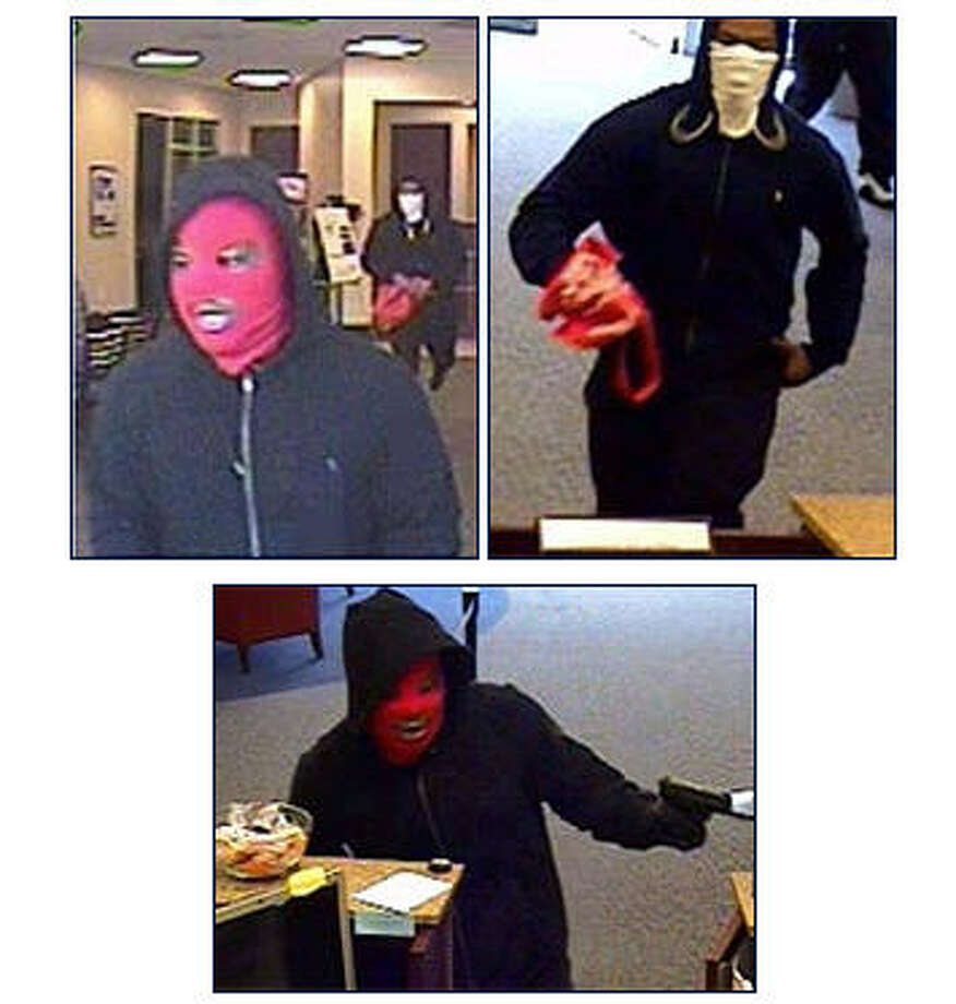 The FBI is releasing photographs of armed bank robbers who took over a busy City Centre bank Monday, Jan. 26, 2015. Three men robbed the Amegy bank located at 800 Town and Country Boulevard, #110 in Houston, Texas. Customers and employees were held at gunpoint during the robbery, although no one was physically hurt. Crime Stoppers of Houston is offering an up to $5,000 reward in the case.PHOTOS: More bank robbers and the ridiculous names given to them by the FBI ...