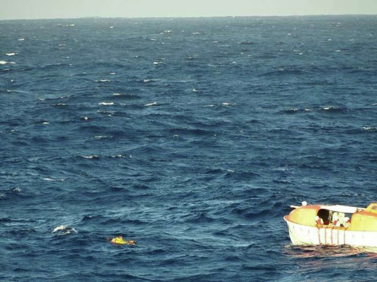 Crew members of the Holland America Motor Ship Veendam rescue a pilot who had ditched his single-engine Cirrus SR-22 off the coast of Maui, Hawaii.