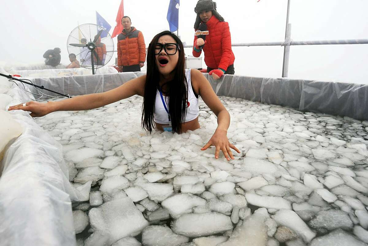 AND THE WINNER OF THE HYPOTHERMIA CHALLENGE IS ... Not her. A man named Chen Kecai outlasted all challengers in a cold endurance contest on Zhangjiajie's Tianmen Mountain in central China. He spent 64 minutes in the ice water.